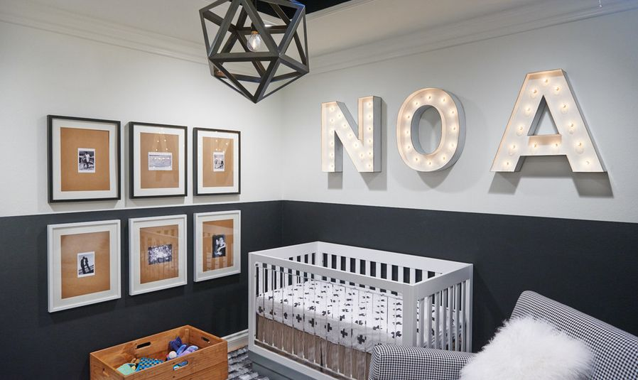Modern NOA nursery room with grey accents